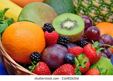 Healthy fresh fruits in a basket on table