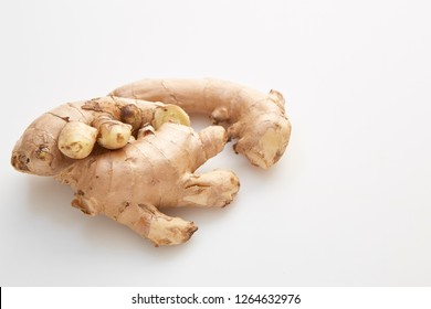 Healthy Fresh Ginger root with medicinal properties and is the elixir on white background