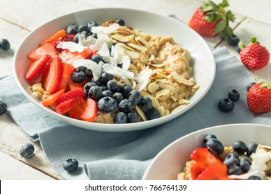 Healthy Fresh Oatmeal with Strawberries Almonds Blueberries and Coconut