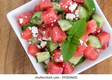 Healthy Fresh Organic Watermelon Salad with Mint, feta cheese and Cucumber closeup