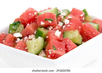 Healthy Fresh Organic Watermelon Salad with Mint, feta cheese and Cucumber over white background