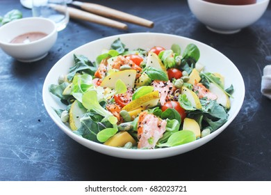 healthy fresh salad with smoked salmon, mango, avocado and tomatoes - Shutterstock ID 682023721