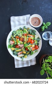 healthy fresh salad with smoked salmon, mango, avocado and tomatoes - Shutterstock ID 682023724