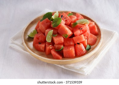 Healthy fresh watermelon salad with mint and lime