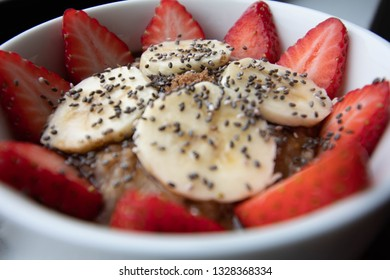 Healthy fruit bowl of oatmeal, strawberry, banana