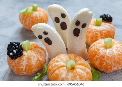 Healthy Fruit Halloween Treats. Banana Ghosts and Clementine Orange Pumpkins
