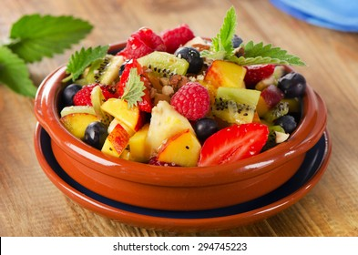 Healthy fruit salad with mint leaves . Selective focus