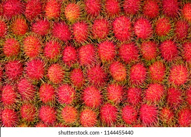 Healthy fruits rambutans background, red Healthy fruits rambutans, rambutans in a supermarket local market of rambutans ready to eat, sweet Thai fruit.