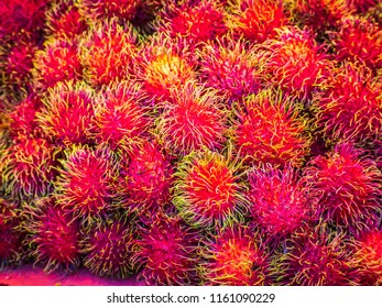 Healthy fruits rambutans background, red green Healthy fruits rambutans, rambutans in a supermarket local market of rambutans ready to eat.