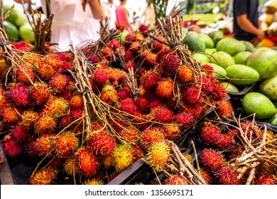 Healthy fruits rambutans background, red Healthy fruits rambutans, rambutans in a supermarket local market of rambutans ready to eat, sweet Thai fruit.