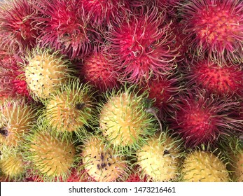 Healthy fruits rambutans background, red Healthy fruits rambutans, rambutans in a supermarket local market of rambutans ready to eat (Selective Focus)