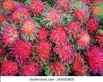 Healthy fruits rambutans background, Rambutans in a supermarket local market of rambutans ready to eat, Rambutan sweet delicious fruit from Thailand