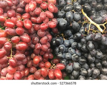 Healthy fruits Red and black wine grapes background  in a supermarket