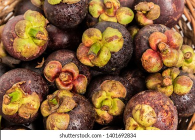 Healthy fruits Red mangosteen background, dark mangosteen, dark mangosteen in a supermarket local market bunch of mangosteen ready to eat.Fresh mangoteen in market. / mangoteen background