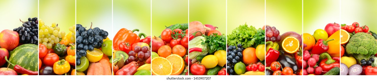 Healthy fruits, vegetables and berries on green background.