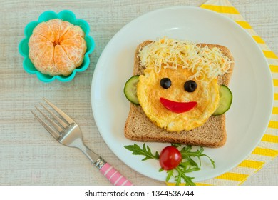 Healthy and fun food for kids, happy face omelette with cheese and vegetables