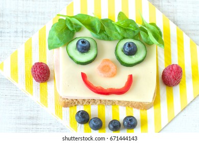 Healthy and fun food for kids, happy and funny face sandwich