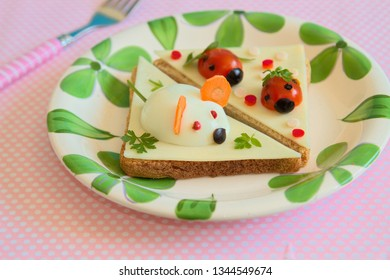 Healthy and fun food for kidswith hard boiled egg  mouse and tomato lady bug on a cheese sandwiches