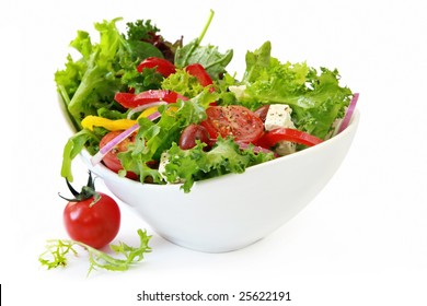 Healthy garden salad in stylish white bowl, isolated on white.