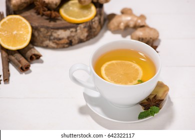 Healthy ginger tea ingredients on a wooden table