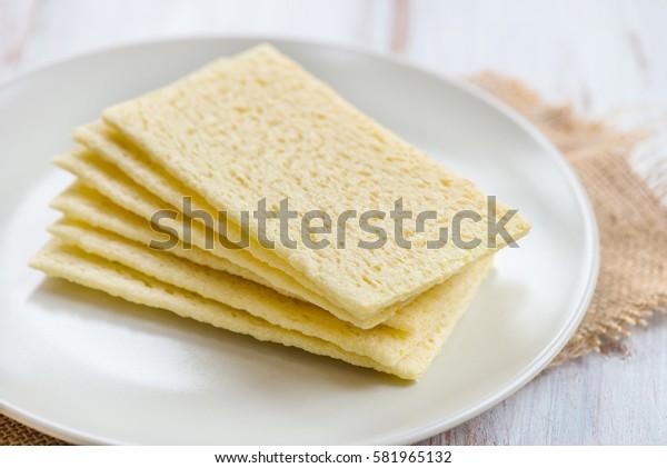 Healthy Gluten Free Crispbreads on the Plate, Light Background