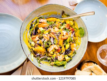 Healthy gourmet salad with avocado, shrimps, sprouted seeds and mango dressing.