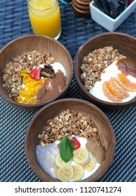 Healthy granola breakfast with 3 bowls