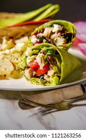 Healthy Greek chicken wrap with herbed potatoes and feta cheese