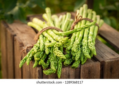 Healthy green asparagus on a wooden box