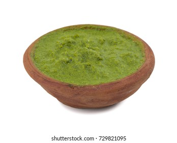 Healthy Green Chutney Made with Coriander, Mint And Spices. isolated on White Background.