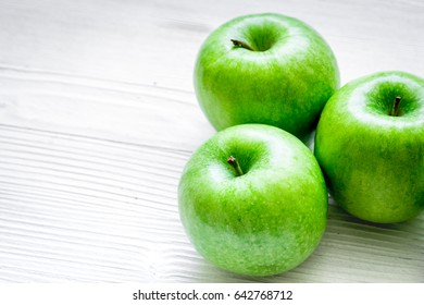 Healthy green food with apples on kitchen white background