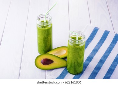 Healthy green organic smoothies on the table