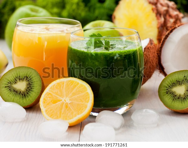 Healthy green and pineapple smoothie with ice
