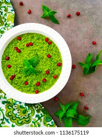 Healthy Green pudina Chutney or mint hummus. Made with Green chilli,Coriander leaves,Mint leaves And Spices. isolated on Background