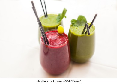 Healthy green and red smoothies - superfoods, detox, diet, health, vegetarian food concept