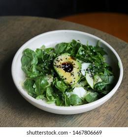 Healthy green salad with avocado