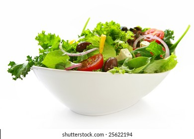 Healthy green salad, in stylish white bowl.  Isolated on white.