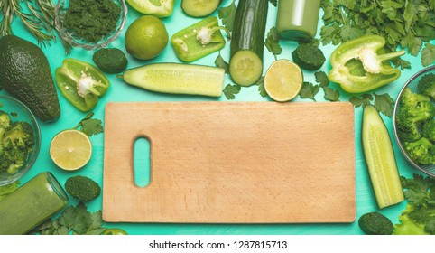 Healthy green vegan cooking ingredients. Flay-lay with wooden daunting and green vegetables and greens, top view. Clean food, vegetarian, , diet food.