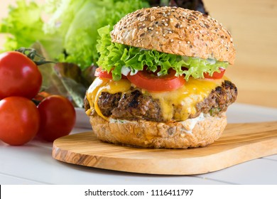 healthy grilled beef burger cheeseburger salad tomato wooden board