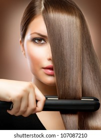Healthy Hair. Hairstyling. Hairdressing. Hair Straightening Irons.Beautiful Woman with  Long Straight Hair