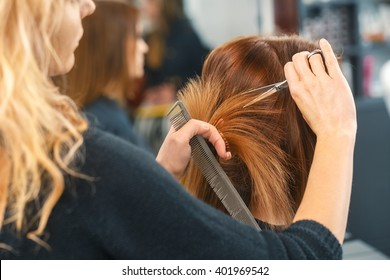Healthy hair tips. Cropped shot of a female client receiving a haircut at the local beauty salon