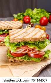 Healthy Ham, Salami, Cheese and Vegetables Sandwiches on Toasted Whole Grain Bread