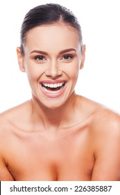Healthy and happy. Beautiful young shirtless woman laughing while standing against white background