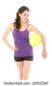 Healthy happy hispanic woman poses with a big tennis ball