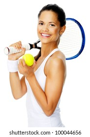 Healthy happy hispanic woman with a wristband poses with a tennis racket while holding tennis ball