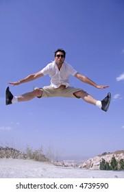 healthy happy man jumping in joy of life
