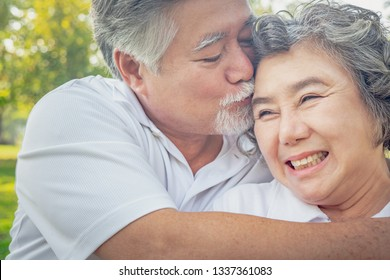 healthy happy mature couple smiling embracing health care in park , People retirement lifestyle concept.
