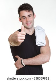 Healthy happy young man thumb up with towel isolated on white background