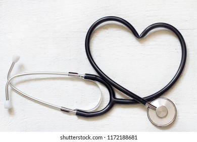 Healthy heart alternative medicine concept with stethoscope on white background