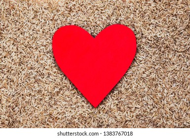 Healthy heart and wholemeal rice - food concept for loving rice, a healthy diet, dieting, lifestyle & nutrition - with lots of design space.